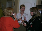 Jana Grover, Karen Swan and Patti Monger visit at the party.