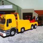 Iveco 8x4 wrecker .i have a collection of wilts and dorset buses .. this is a replica of one of their wreckers . I had to modify the rti cab so i filed the wind deflector or .. and the rear filed flat . then built the roof up to make a taller roof pod .I then set about scratch-building the chassis and the body. The underlift is made from evergreen plasticard and is a working one, posed up or down seen with a burnt out bus on tow