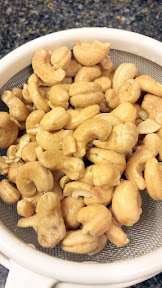 After 2 hours of soaking, drain the water from the cashews