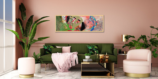 Art Deco styled room with large plant, pink accents, and framed fine art