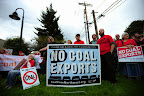 Protesters gather outside the Longview Coal Exports Hearing against the proposed Millennium Bulk Terminal which would export 44 million tons of coal annually to Asia.