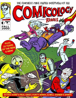 The Atomics blasting and running towards their foe, one member swinging from the elastic arms of another, below 'Comicology' logo, with magazine trade dress