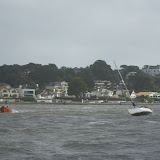 View from the ALB as the ILB manoeuvres close to an 8 metre yacht which has run aground in Whitley Lake - 27 October 2013. Photo credit: RNLI Poole