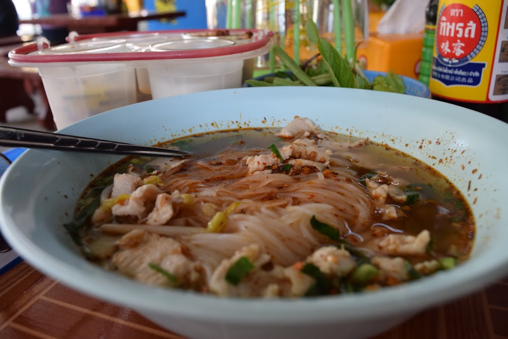 enjoying some delicious guey tiaw, Lao style... basically the same amount of deliciousness as its Thai counterpart...