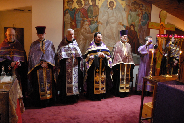 The clergy stand at the high place of the altar for the exclamation of the prokeimenon, beginning a new liturgical day.
