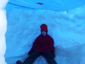 Tarp-roofed snow block shelter