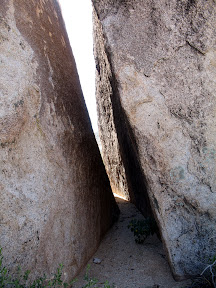 Narrow slot between two large boulders