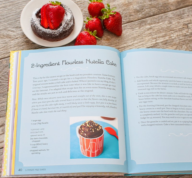 photo of an opened cookbook and a nutella cake