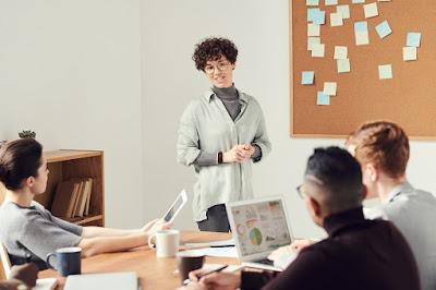 Woman presenting selfhelpgeek.com