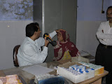 The eye doctor examines a villager