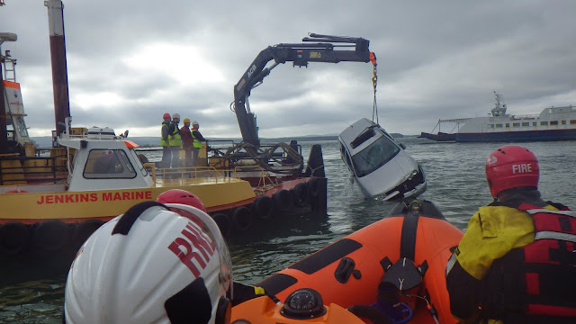 A view from the ILB as the vehicle is raised by a Jenkins Marine barge - 27 October 2014.  Photo credit: RNLI/Poole