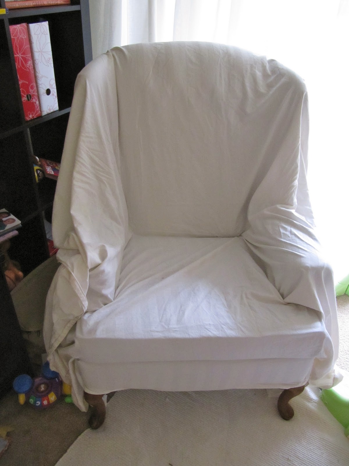 First I Threw The Sheet Over The Chair, Making The Satin Stripes Run  Vertically Down. I Started Tucking Like Mad!