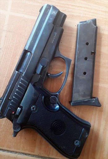 The pistol recovered from the slain suspected gangster. /COURTESY