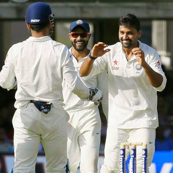 India's Murali Vijay, right, celebrates the wicket of England's Moeen Ali, during the second day of the second test match between England and India at Lord's cricket ground in London, Friday, July 18, 2014.
