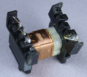 The second half of the primary winding in the flyback transformer. The 3mm boundary tape is clearly visible at the right.