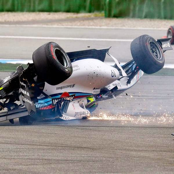 Williams Formula One driver Felipe Massa of Brazil crashes with his car in the first corner after the start of the German F1 Grand Prix at the Hockenheim racing circuit, July 20, 2014.