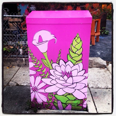 utility box mural painted near stony brook station in jamaica plain boston a mural of lilies and lotus with a pretty purplish fuchsia background