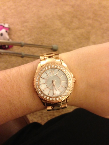 A picture of a Michael Kors style dupe watch on an arm from River Island