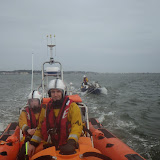 The ILB tows the stricken yacht towards Poole Quay, with Ed Davies at the helm - 17 October 2014.  Photo credit: RNLI/Poole