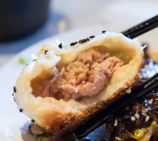 close-up photo of the inside of one Sheng Jian Bao
