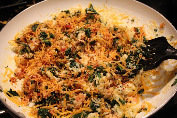Add in the spinach, shredded cheese. Add about a 1/2 cup of chunky salsa,...