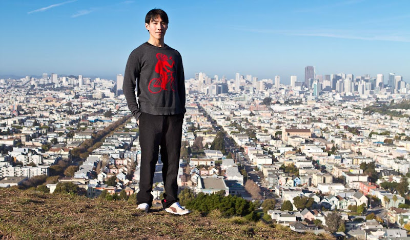 Exceptionally handsome man towers above San Francisco