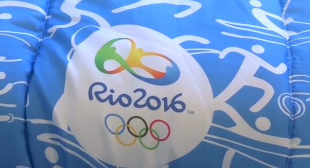 A bed comforter bears the logo for the 2016 Olympics in Rio. Less than two months before it hosts the Olympic Games, the Brazilian state of Rio de Janeiro has declared a state of financial emergency and has asked for funding during the Games. About half a million tourists are expected in Rio during the Games. Photo: TV Globo
