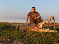 Mr Kosa from Hungary with a big crocodile, 4m.