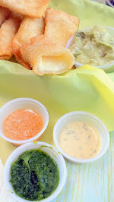 Las Primas addictive appetizer ofTequeños (Venezuelan Cheese Sticks), a queso blanco filled fried wonton snack served with avocado-lime dip. I also endorse getting all the little sauces and using this as your vehicle for all of them