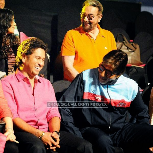 Sachin Tendulkar and Amitabh Bachchan share a light moment during the opening match of Pro-Kabbadi League, held in Mumbai, on July 26, 2014. (Pic: Viral Bhayani) <br /> <br />