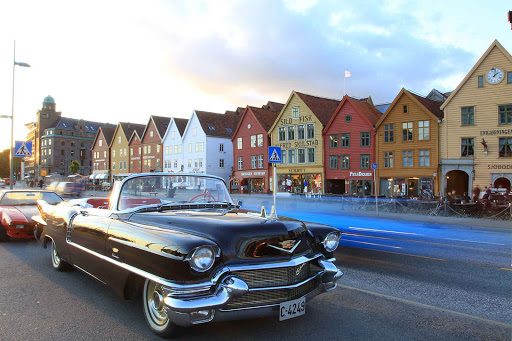 Norway-Bergen-Bryggen-benches - Norwegian summers bring outdoor dining and classic cars to Bryggen, near Bergen, Norway.