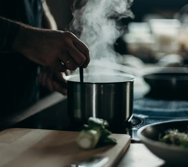Cooking bulalo soup in a pot