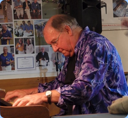 Our guest artist, Joe Fingers, playing the acoustic piano. Photo courtesy of Dennis Lyons.