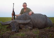 Mr Peter Vermuelen, Australia with a fine old sweeper bull, taken on the plains on sunset.