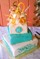 Off set teal, white and gold  square fondant custom 50th anniversary cake design with edible bow topper, monogram and sugar pearls