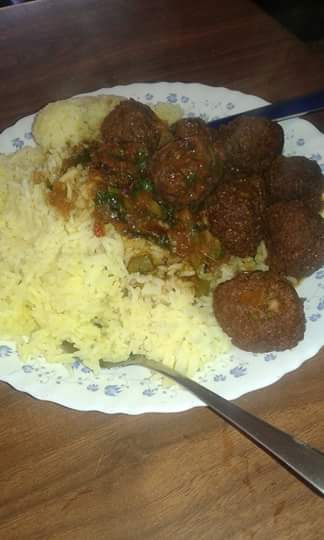 Meatballs in tomato sauce with rice