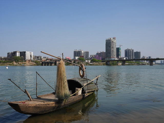 small boat in the Xiang River in Hengyang, China