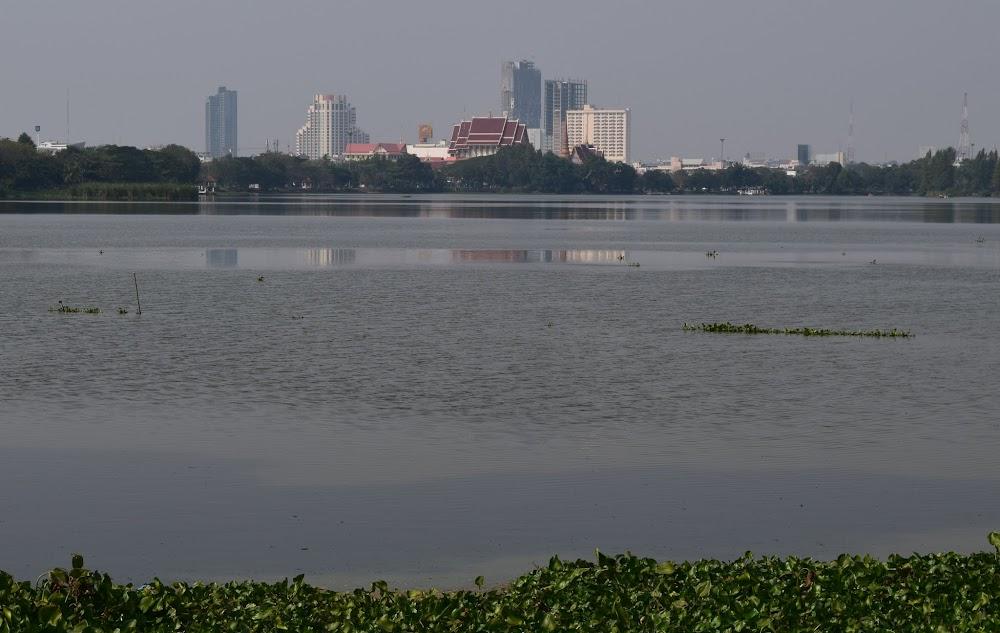 The Khon Kaen skyline looms beyond the lake...