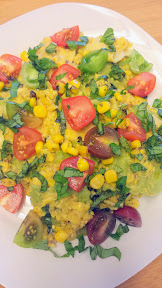 Ravioli with Corn Sauce Recipe with Basil and Grape Tomatoes. The corn sauce is almost like a pesto but with corn and toasted almonds instead