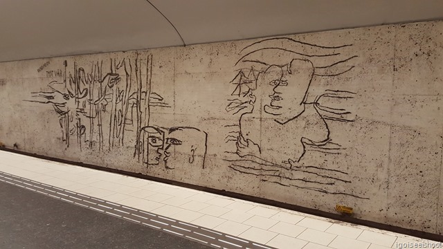 Östermalmstorg Station features the work of Siri Derkert, one of Sweden's most famous artists in the 20th century, on the walls by the tracks.