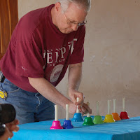 Dad showing how to play bells.
