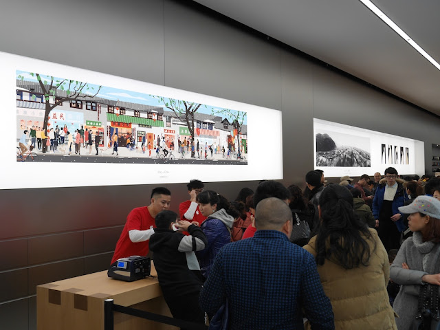 artwork on walls of Jiefangbei Apple Store on opening day