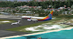 A Gulfstream awaits its turn as the Air Jamaica 738 arrives at Montego Bay