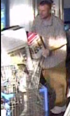 SUSPECT PUSHES CART OUT