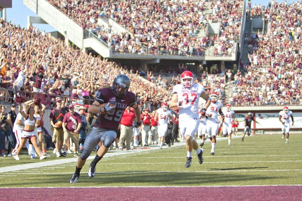 UM's Bryce Carver sails into the endzone untouched after a 39-yard trick pass from UM tight end Greg Hardy.  Washington - Grizzly Stadium, Montana Grizzlies vs. South Dakota Coyotes.  Missoula, MT, September 1st, 2012.