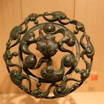 """Musée d'archéologie nationale, Age du fer : n° 6 couvercle en bronze, tombe à char 1002 (Roissy-en-France, """"La Fosse Cotheret"""", Val-d'Oise)"""
