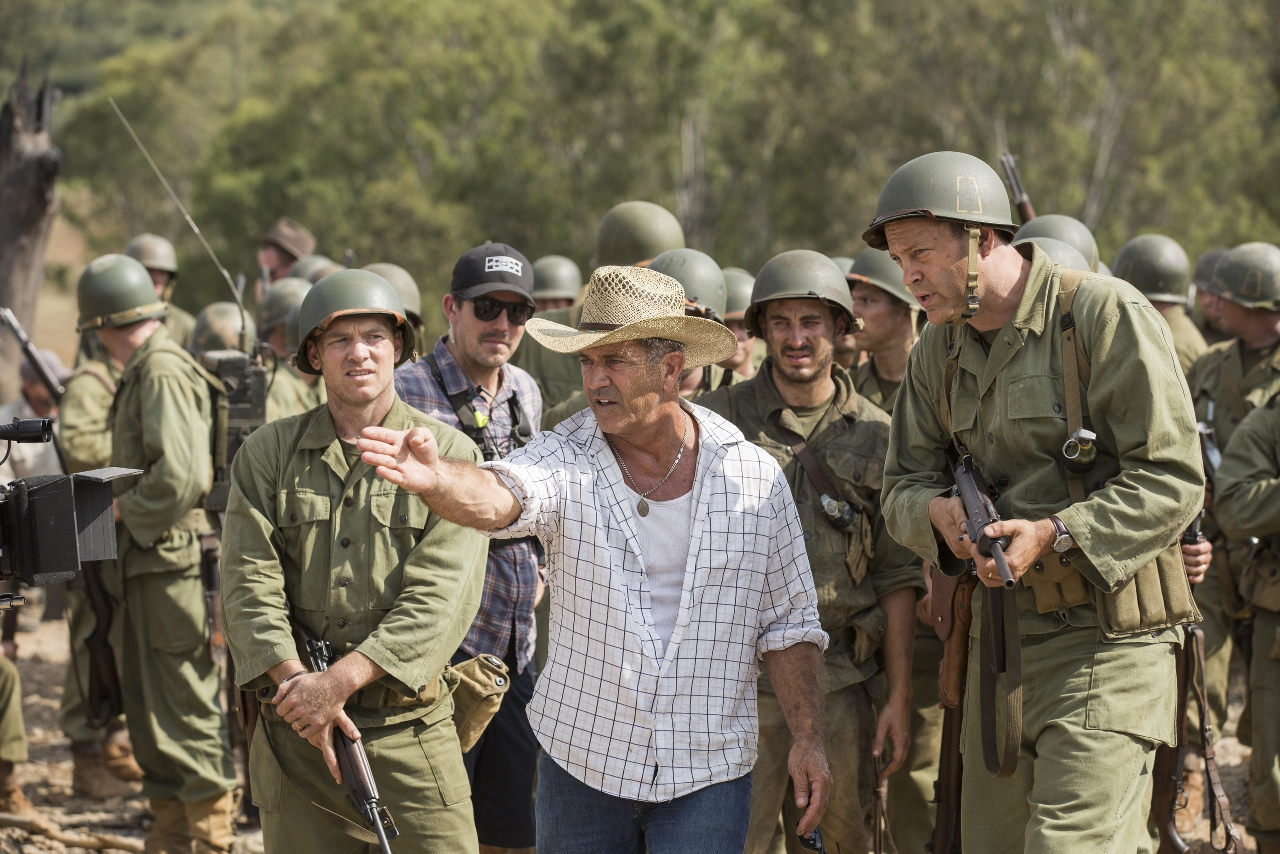 (L-R) Sam Worthington, Director Mel Gibson, and Vince Vaughn on the set of HACKSAW RIDGE. (Photo by Mark Rogers / Lionsgate).