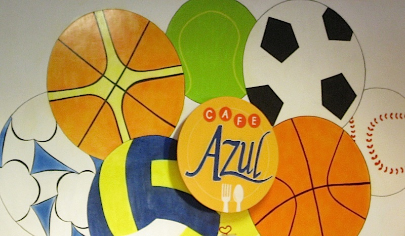 Café Azul's logo on a mural of balls
