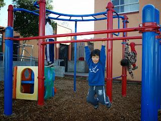 Aaron swings on monkey bars first recess back