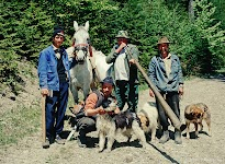 The crew. Sheep shepherd family on their way to their flock of sheep up in the mountains forests.